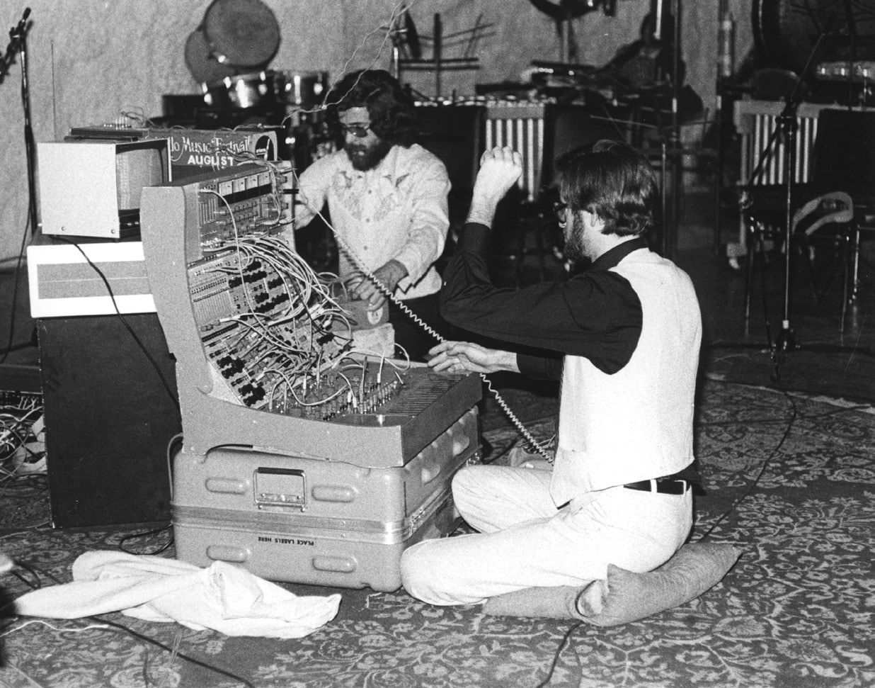 Electronic instrument designer Donald Buchla (left) with Rosenboom (right) at Music Gallery, Toronto, 1978, performing his How Much Better if Plymouth Rock Had Landed on the Pilgrims, Section V (humanity).