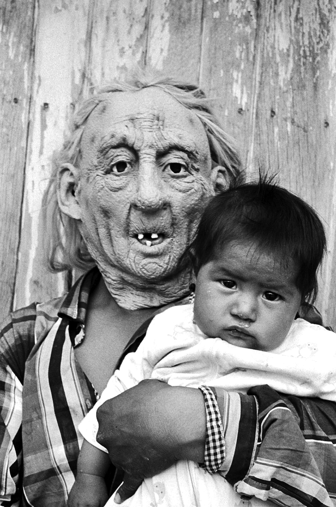 Joel Orozco, Beyond the Mask: Person Wearing Mask Holds Child