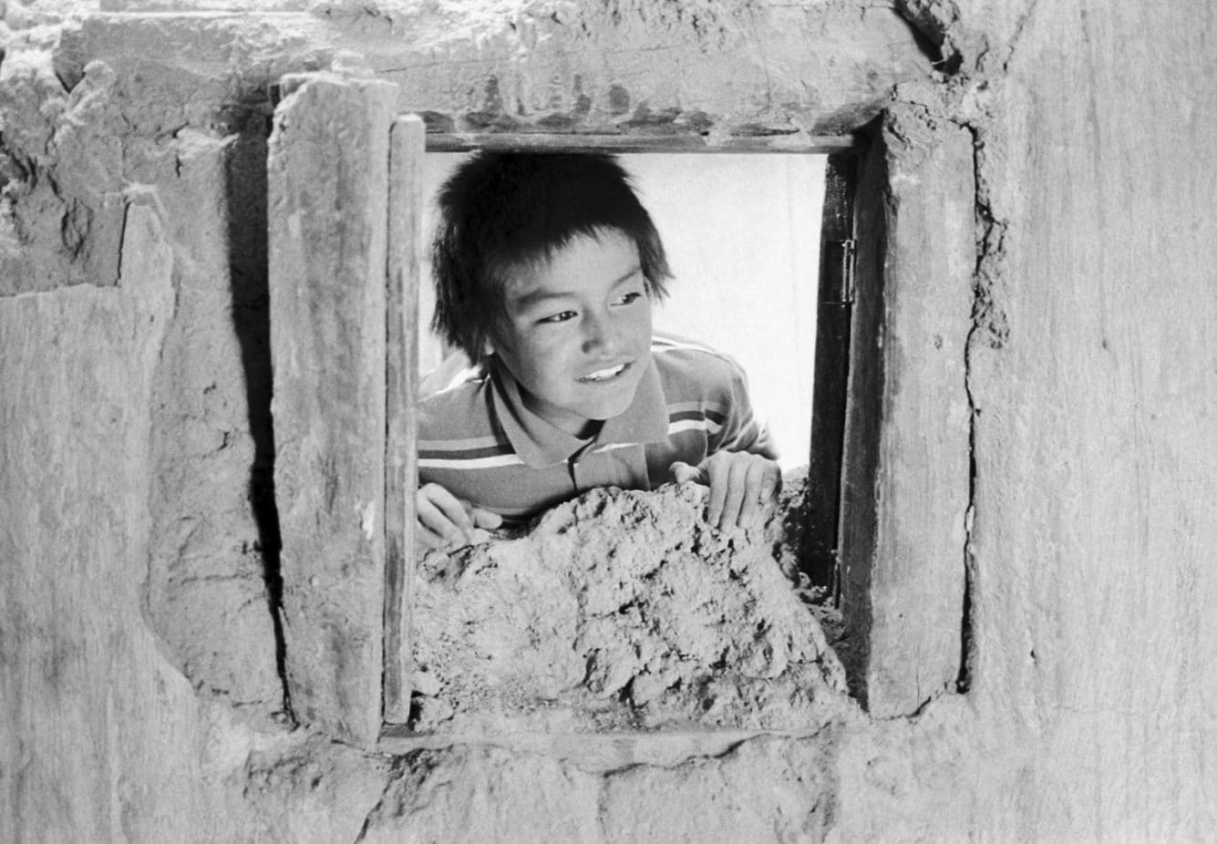 Joel Orozco, Beyond the Mask: Child Looking out of Window