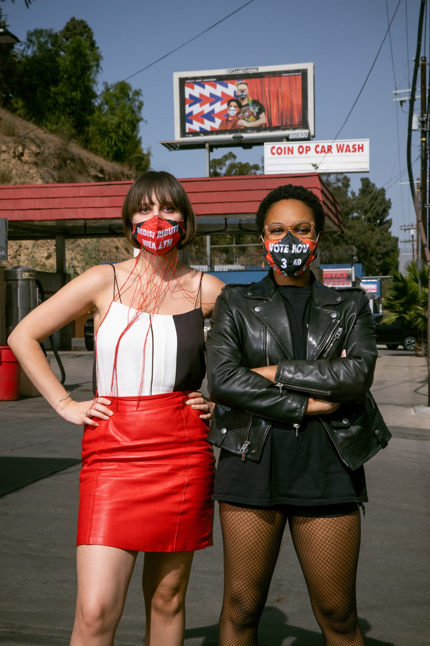 Artist Molly Surazhsky and collaborator Courtney Coles in front of one of the  PPE • People's Power Enhancement's billboards.   Photo: Rafael Hernandez/CalArts.